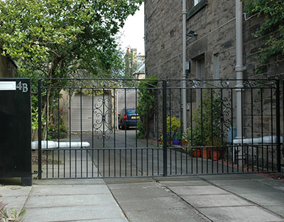 Iron traditional gate with automatic entry control